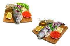 Trout, vegetables, red caviar and spices on a white background. Horizontal photo Royalty Free Stock Image
