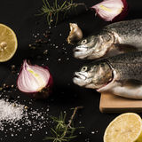 Trouts with ingredients Royalty Free Stock Image