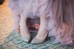 Trouwringen, schoenen en kleding, Stock Foto's