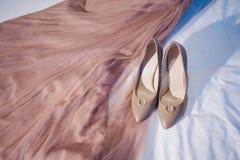 Trouwringen, schoenen en kleding, Royalty-vrije Stock Afbeeldingen