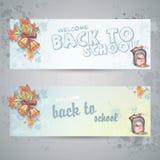 Trouxa da escola e folhas de outono Foto de Stock Royalty Free