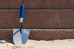 Trowel on the beach Royalty Free Stock Photo