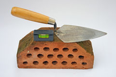 Trowel on a brick. Stock Image
