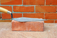 Trowel on brick. Stock Images