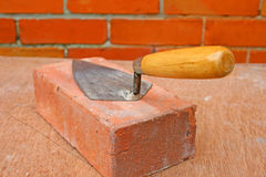 Trowel on a brick. Royalty Free Stock Image