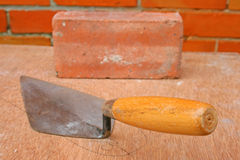 Trowel and brick. Stock Image