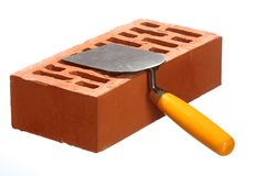 Trowel and a brick Stock Images