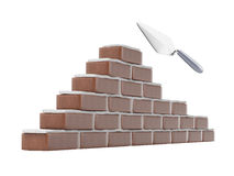 Trowel and brick wall Stock Photos