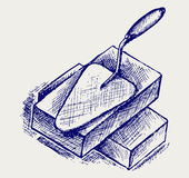 Trowel and bricks. Doodle style. Vector Stock Photography