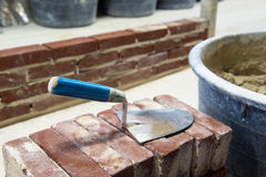 Trowel and bricks Stock Photo