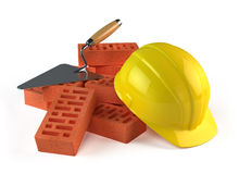 Trowel, Bricks and Construction helmet Royalty Free Stock Photos