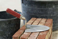 Trowel and bricks Stock Photos