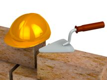 Trowel, bricks, yellow plastic helmet Royalty Free Stock Photo