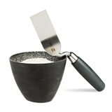 Trowel with bucket of filler Royalty Free Stock Photos