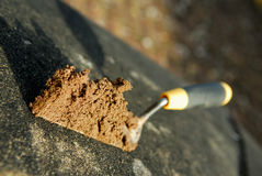 Trowel and cement.