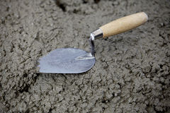 Trowel and cement Stock Photo