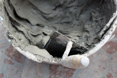Trowel and cement Royalty Free Stock Photography