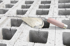 Trowel on cinderblock gray background. against the background of the brickwork is trowel.  Stock Images