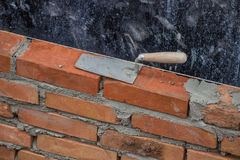 Trowel on a clay bricks Royalty Free Stock Image