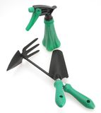 Trowel Cutivator and Sprayer. Gardening tools trowel cultivator sprayer for planting and weeding white background stock images