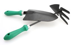 Trowel and Cutivator White Backgroung. Gardening tools trowel and cultivator for planting and weeding white backgroung Royalty Free Stock Photos