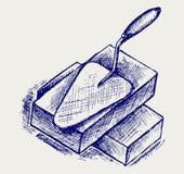 Trowel e tijolos ilustração do vetor