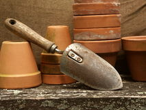 Trowel with flowerpots Royalty Free Stock Photo