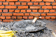 Trowel in fresh cement Stock Photo