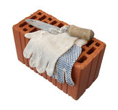 Trowel and gauntlet with red brick. Stock Images