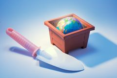 Trowel with Globe in Flower Pot Stock Photography