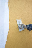 Trowel with glove hand plastering a wall Stock Photography