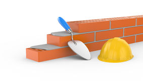 Trowel, helmet and brick Stock Photo