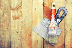 Trowel and paint brush Stock Photo