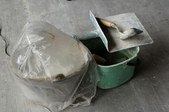 Trowel plaster is placed on floor. royalty free stock images
