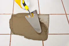 Trowel puts adhesive on hole Stock Images