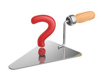 Trowel and a question mark Stock Images