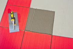 Trowel on red tiles Stock Photos