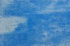 Trowel scratched background with dry plastering. Scratched blue texture. Royalty Free Stock Photo