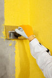 A trowel spreading a plaster on a corner-wall Stock Photo