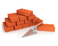 Trowel and stack of bricks. Isolated on white Royalty Free Stock Images