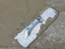 Trowel and wet cement Royalty Free Stock Images