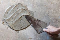 trowel with wet concrete stock photography