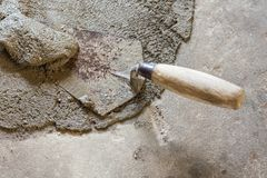 Trowel with wet concrete stock image