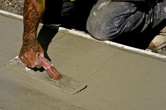 Troweling wet concrete Royalty Free Stock Images