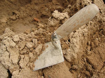 Trowell and Sand. Builder's trowell in a pile of sand royalty free stock photography