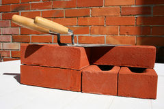 Trowels and bricks. Stock Photo