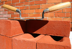Trowels, bricks and mortar. Royalty Free Stock Images