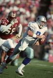 Troy Aikman Dallas Cowboys. Troy Aikman of the Dallas Cowboys running out of the pocket for long yardage. Game was played in SanFrancisco Stock Photography