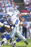 Troy Aikman and Michael Strahan. Defensive End Michael Strahan of the New York Giants in game action againist the Dallas Cowboys. The New York Giants went on to Royalty Free Stock Image