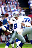 Troy Aikman sacked by Michael Strahan. Quarterback Troy Aikman of the Dallas Cowboys is pulled down by the Giants DL Michael Strahan 92 Royalty Free Stock Images